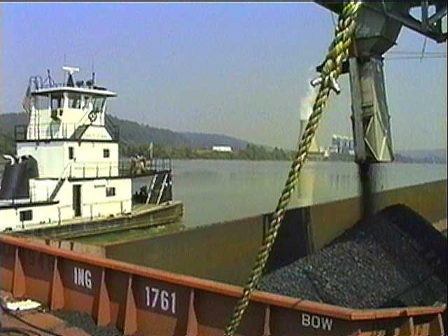 Watch as the coal is delivered and unloaded onto a barge for a trip down the Ohio River.