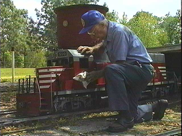 John Cassady polishes a GP-40 made by the person who built models for the Supertrain movie.