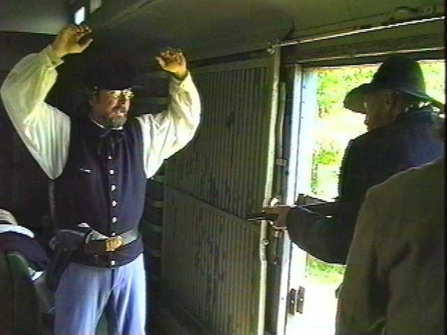 The train is held up at gunpoint... thieves take all of the gold being stored in the mail car.