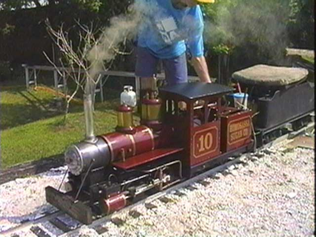 A live steam locomotive is fired up for a trip around the Manatee Central RR in central Florida.