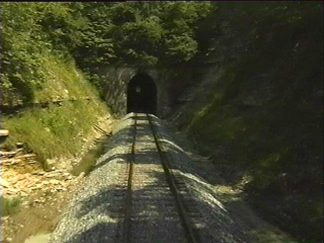 Approaching one of the tunnels that cut through mountains; see what it's like to ride through it!
